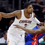 Cleveland Cavaliers' Kyrie Irving (2) commits an offensive foul against Detroit Pistons' Brandon Knight in the third quarter of an NBA basketball game on Wednesday, April 10, 2013, in Clevel …