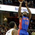 Detroit Pistons' Will Bynum (12) shoots over Cleveland Cavaliers' Kyrie Irving in the third quarter of an NBA basketball game on Wednesday, April 10, 2013, in Cleveland. Bynum scored 16 poin …