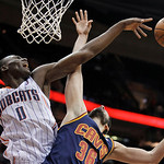 Charlotte Bobcats' Bismack Biyombo (0) blocks a shot by Cleveland Cavaliers' Omri Casspi (36) during the fourth quarter of an NBA basketball game Tuesday, April 10, 2012, in Cleveland. The C …