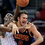 Charlotte Bobcats' Bismack Biyombo, left, and Cleveland Cavaliers' Semih Erden (9)collide while chasing a rebound in the fourth quarter of an NBA basketball game Tuesday, April 10, 2012, in  …