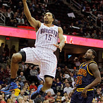 Charlotte Bobcats' Gerald Henderson, left, beats Cleveland Cavaliers' Donald Sloan to the basket in the third quarter of an NBA basketball game Tuesday, April 10, 2012, in Cleveland. Henders …