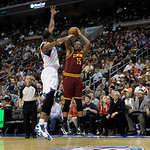 Cleveland Cavaliers' Marreese Speights (15) shoots over Philadelphia 76ers' Thaddeus Young (21) during an NBA basketball game, Sunday, April 14, 2013, in Philadelphia. The 76ers won 91-77. ( …