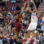 Philadelphia 76ers' Evan Turner (12) shoots over Cleveland Cavaliers' Alonzo Gee (33) during an NBA basketball game, Sunday, April 14, 2013, in Philadelphia. The 76ers won 91-77. (AP Photo/M …