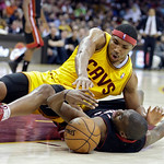 Cleveland Cavaliers' Kevin Jones, top, and Miami Heat's Jarvis Varnado fight for a loose ball in the fourth quarter of an NBA basketball game Monday, April 15, 2013, in Cleveland. Miami won  …