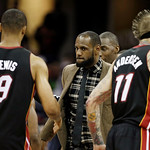 Miami Heat's LeBron James, center, congratulates his teammates after a 96-95 win over the Cleveland Cavaliers in an NBA basketball game Monday, April 15, 2013, in Cleveland. James sat out th …