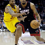 Cleveland Cavaliers' Alonzo Gee, left, tries to knock the ball away from Miami Heat's Rashard Lewis in the first quarter of an NBA basketball game Monday, April 15, 2013, in Cleveland. (AP P …