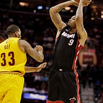 Miami Heat's Rashard Lewis (9) shoots over Cleveland Cavaliers' Alonzo Gee (33) in the fourth quarter of an NBA basketball game Monday, April 15, 2013, in Cleveland. Lewis led the Heat with  …