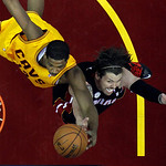 Cleveland Cavaliers' Tristan Thompson, left, shoots against Miami Heat's Mike Miller in the first half of an NBA basketball game Monday, April 15, 2013, in Cleveland. (AP Photo/Mark Duncan)
