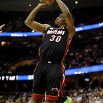 Miami Heat's Norris Cole shoots against the Cleveland Cavaliers in the first quarter of an NBA basketball game Monday, April 15, 2013, in Cleveland. (AP Photo/Mark Duncan)