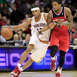 Cleveland Cavaliers' D.J. Kennedy (12) drives to the basket under pressure from Washington Wizards' Cartier Martin (20) in the second quarter in an NBA basketball game on Wednesday, April 25 …