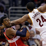 Washington Wizards' John Wall, left, grabs the ball away from Cleveland Cavaliers' Samardo Samuels (24) in the third quarter of an NBA basketball game on Wednesday, April 25, 2012, in Clevel …
