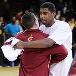 Cleveland Cavaliers' Kyrie Irving, right, hugs a fan during fan appreciation after an NBA basketball game between the Cavaliers and the Washington Wizards, Wednesday, April 25, 2012, in Clev …