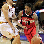 Washington Wizards' Cartier Martin (20) drives past Cleveland Cavaliers' Anthony Parker (18) in the first quarter in an NBA basketball game on Wednesday, April 25, 2012, in Cleveland. (AP Ph …