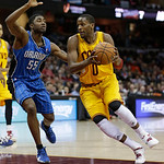 Cleveland Cavaliers' C.J. Miles (0) drives past Orlando Magic's E'Twaun Moore (55) during the second quarter of an NBA basketball game Sunday, April 7, 2013, in Cleveland. (AP Photo/Tony Dej …