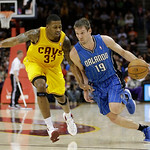Orlando Magic's Beno Udrih (19), from Slovenia, drives past Cleveland Cavaliers' Alonzo Gee (33) during the first quarter of an NBA basketball game Sunday, April 7, 2013, in Cleveland. The C …