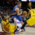 Orlando Magic's Beno Udrih (19), from Slovenia, loses control of the ball trying to squeeze between Cleveland Cavaliers' Wayne Ellington (21) and Shaun Livingston (14) during the fourth quar …