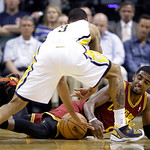 Cleveland Cavaliers guard Kyrie Irving, bottom, looks to grab a loose ball in front of Indiana Pacers guard George Hill in the first half of an NBA basketball game in Indianapolis, Tuesday,  …
