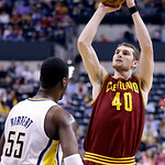Cleveland Cavaliers center Tyler Zeller, right, shoots over Indiana Pacers center Roy Hibbert in the first half of an NBA basketball game in Indianapolis, Tuesday, April 9, 2013. (AP Photo/M …