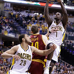 Indiana Pacers guard Lance Stephenson (1) shoots over Cleveland Cavaliers center Tyler Zeller, center, and Pacers' Jeff Pendergraph in the second half of an NBA basketball game in Indianapol …