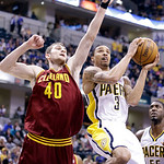 Indiana Pacers guard George Hill, right, goes to the basket and scores in front of Cleveland Cavaliers center Tyler Zeller in the second half of an NBA basketball game in Indianapolis, Tuesd …
