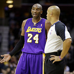 Los Angeles Lakers' Kobe Bryant (24) talks to referee Marc Davis (8) during an NBA basketball game against the Cleveland Cavaliers Tuesday, Dec. 11, 2012, in Cleveland. (AP Photo/Mark Duncan …