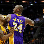 Los Angeles Lakers' Kobe Bryant (24) keeps the ball away from Cleveland Cavaliers' Alonzo Gee in the first quarter of an NBA basketball game, Tuesday, Dec. 11, 2012, in Cleveland. (AP Photo/ …