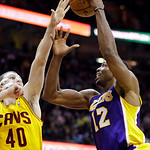 Los Angeles Lakers' Dwight Howard (12) shoots over Cleveland Cavaliers' Tyler Zeller in the third quarter of an NBA basketball game, Tuesday, Dec. 11, 2012, in Cleveland. Howard score 19 poi …
