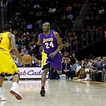 Los Angeles Lakers' Kobe Bryant (24) brings the ball up against Cleveland Cavaliers' Alonzo Gee in an NBA basketball game Tuesday, Dec. 11, 2012, in Cleveland. (AP Photo/Mark Duncan)
