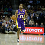 Los Angeles Lakers' Chris Duhon brings the ball up against the Cleveland Cavaliers in an NBA basketball game Tuesday, Dec. 11, 2012, in Cleveland. (AP Photo/Mark Duncan)