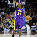 Los Angeles Lakers' Kobe Bryant signals a play in an NBA basketball game against the Cleveland Cavaliers Tuesday, Dec. 11, 2012, in Cleveland. (AP Photo/Mark Duncan)