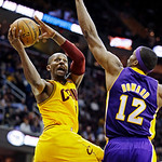 Cleveland Cavaliers' C.J. Miles shoots against Los Angeles Lakers' Dwight Howard (12) in the fourth quarter of an NBA basketball game, Tuesday, Dec. 11, 2012, in Cleveland. Miles scored 28 p …