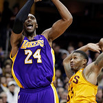 Los Angeles Lakers' Kobe Bryant (24) shoots against Cleveland Cavaliers' Alonzo Gee in the third quarter of an NBA basketball game, Tuesday, Dec. 11, 2012, in Cleveland. Bryant scored 41 poi …