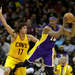 Los Angeles Lakers' Dwight Howard holds the ball away from Cleveland Cavaliers' Anderson Varejao (17), from Brazil,  in an NBA basketball game Tuesday, Dec. 11, 2012, in Cleveland. (AP Photo …