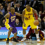 Cleveland Cavaliers' C.J. Miles (0) works against Los Angeles Lakers' Kobe Bryant (24) in an NBA basketball game Tuesday, Dec. 11, 2012, in Cleveland. (AP Photo/Mark Duncan)