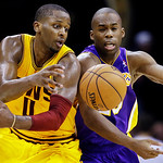 Cleveland Cavaliers' C.J. Miles, left, and Los Angeles Lakers' Jodie Meeks vie for a loose ball in the third quarter of an NBA basketball game, Tuesday, Dec. 11, 2012, in Cleveland. The Cava …