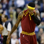 Cleveland Cavaliers' Daniel Gibson wipes his face as he walks to the bench during a timeout in the second half of an NBA basketball game against the Indiana Pacers, Wednesday, Dec. 12, 2012, …