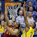 Cleveland Cavaliers' Samardo Samuels (24) puts up a shot against Indiana Pacers' Sam Young (4) during the first half of an NBA basketball game on Wednesday, Dec. 12, 2012, in Indianapolis. ( …