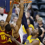 Cleveland Cavaliers' Samardo Samuels (24) dunks against Indiana Pacers' Roy Hibbert during the first half of an NBA basketball game on Wednesday, Dec. 12, 2012, in Indianapolis. (AP Photo/Da …