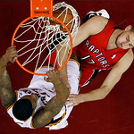 Cleveland Cavaliers' Alonzo Gee, left, dunks on Toronto Raptors' Jonas Valanciunas (17), of Lithuania, in the first half of an NBA basketball game, Tuesday, Dec. 18, 2012, in Cleveland. (AP  …