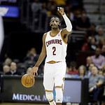 Cleveland Cavaliers' Kyrie Irving signals a play in an NBA basketball game against the Toronto Raptors Tuesday, Dec. 18, 2012, in Cleveland. (AP Photo/Mark Duncan)