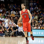 Toronto Raptors' Jose Calderon, from Spain, brings the ball up against the Cleveland Cavaliers in an NBA basketball game Tuesday, Dec. 18, 2012, in Cleveland. (AP Photo/Mark Duncan)