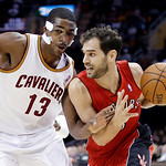 Toronto Raptors' Jose Calderon, from Spain, drives on Cleveland Cavaliers' Tristan Thompson (13) in the first quarter of an NBA basketball game, Tuesday, Dec. 18, 2012, in Cleveland. (AP Pho …