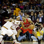 Toronto Raptors' Alan Anderson (6) is defended by Cleveland Cavaliers' Daniel Gibson (1) and Tristan Thompson in an NBA basketball game Tuesday, Dec. 18, 2012, in Cleveland. (AP Photo/Mark D …