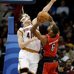 Cleveland Cavaliers' Tyler Zeller defends Toronto Raptors' Alan Anderson (6) in an NBA basketball game Tuesday, Dec. 18, 2012, in Cleveland. (AP Photo/Mark Duncan)