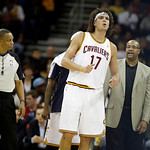 Cleveland Cavaliers' Anderson Varejao (17), from Brazil,  grimaces after hitting the floor in an NBA basketball game against the Toronto Raptors Tuesday, Dec. 18, 2012, in Cleveland. (AP Pho …