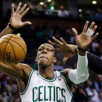 The ball gets away from Boston Celtics point guard Rajon Rondo as he is fouled by Cleveland Cavaliers small forward C.J. Miles during the first quarter of an NBA basketball game in Boston, W …