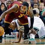 Cleveland Cavaliers guard Kyrie Irving (2) comes up with a loose ball against Boston Celtics forward Paul Pierce, rear, during the second half of an NBA basketball game in Boston, Wednesday, …