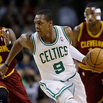 Boston Celtics point guard Rajon Rondo (9) dribbles the ball after stealing it from Cleveland Cavaliers point guard Kyrie Irving (2) as Cavaliers forward Tristan Thompson, right, watches, du …