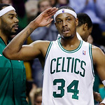 Boston Celtics forward Paul Pierce (34) acknowledges the crowd as he leaves the court late in the fourth quarter of an NBA basketball game against the Cleveland Cavaliers in Boston, Wednesda …
