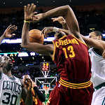 Cleveland Cavaliers forward Tristan Thompson (13) is fouled as he drives to the basket between Boston Celtics forward Brandon Bass (30) and center Jason Collins, right, during the fourth qua …